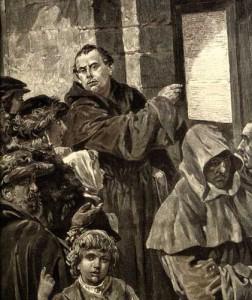 Martin Luther nagelt seine 95 Thesen an die Schlosskirche von Wittenberg